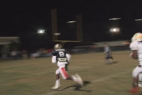 Island Coast's Reshad Washington scores a 45-yard touchdown for the North Team.
