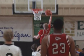 Maverick Rowan dunks for two in Cardinal Gibbons' win over Mariner.